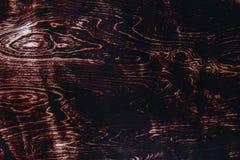 Textura de um corte marrom de uma ?rvore com um n? do envernizado Fim do fundo do vintage acima fotografia de stock royalty free
