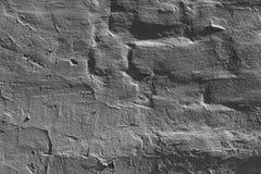A textura de um mármore da parede lapida o backgroun cinzento médio com jogo de sombras para o projeto foto de stock