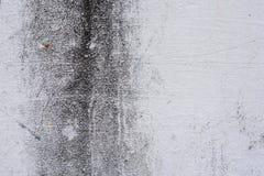Textura de um muro de cimento com quebras e riscos que podem ser usados como um fundo imagem de stock