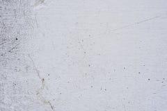 Textura de um muro de cimento com quebras e riscos que podem ser usados como um fundo foto de stock