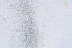 Textura de um muro de cimento com quebras e riscos que podem ser usados como um fundo fotos de stock
