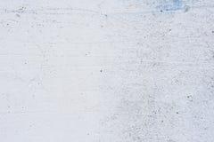 Textura de um muro de cimento com quebras e riscos que podem ser usados como um fundo imagens de stock royalty free