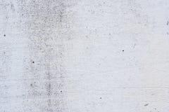 Textura de um muro de cimento com quebras e riscos que podem ser usados como um fundo imagens de stock
