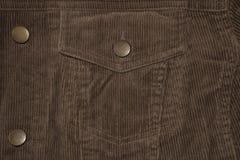 Textura de um revestimento do veludo de algodão, de um bolso do veludo de algodão e de uns botões velhos foto de stock
