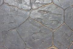 Textura de um revestimento escuro ou de pedras com areia Fotos de Stock Royalty Free