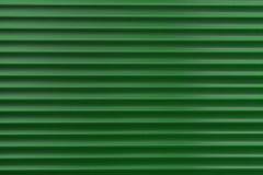 A textura de um rolo do metal de cores diferentes O fundo das cortinas do ferro Obturadores protetores do rolo para a porta de en Imagens de Stock Royalty Free