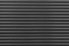 A textura de um rolo do metal de cores diferentes O fundo das cortinas do ferro Obturadores protetores do rolo para a porta de en Imagens de Stock
