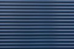 A textura de um rolo do metal de cores diferentes O fundo das cortinas do ferro Obturadores protetores do rolo para a porta de en Imagem de Stock Royalty Free