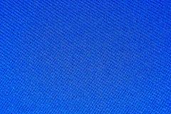 Textura de um synthetic, pano azul uniformemente iluminado foto de stock royalty free