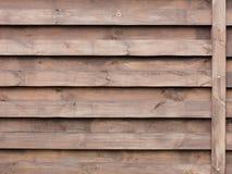 Textura de uma cerca de madeira com um fundo marrom horizontal novo Fotografia de Stock Royalty Free