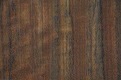 A textura de uma madeira exótica O fundo é marrom, vermelho, amarelo fotos de stock