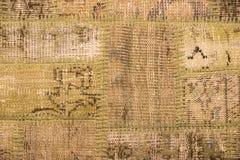 Textura de uma parte de tapete velho Imagens de Stock