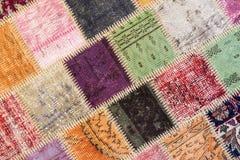Textura de uma parte de tapete velho Fotos de Stock Royalty Free
