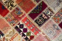 Textura de uma parte de tapete velho Foto de Stock