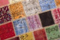 Textura de uma parte de tapete velho Fotos de Stock