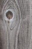 Textura de uma placa de madeira velha com quebras do colo cinzento e marrom Foto de Stock
