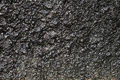Textura de uma superfície áspera preta imagens de stock