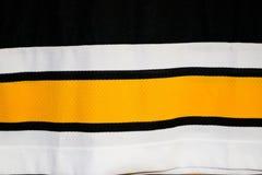 Textura de uma tela alemão sintética preta amarela branca multi-colorida O fundo imagens de stock