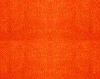 Textura de uma toalha alaranjada do algodão Fotos de Stock Royalty Free