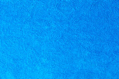 Textura de uma toalha azul do algodão como um fundo Fotos de Stock Royalty Free