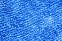 Textura de un fondo azul de la tela Foto de archivo libre de regalías