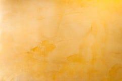Textura de un hormigón amarillo como fondo imagen de archivo