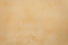 Textura de un hormigón del marrón amarillo como fondo imagen de archivo libre de regalías