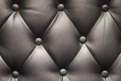 Textura de un sofá de cuero negro Imagen de archivo