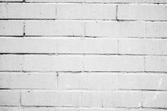 Textura de una pared blanca con los ladrillos Imágenes de archivo libres de regalías