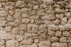 Textura de una pared de piedra Viejo fondo de la textura de la pared de piedra del castillo Pared de piedra como un fondo o textu imágenes de archivo libres de regalías
