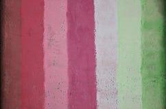 Textura de una pared vieja del metal, pintada en varios diverso color Imágenes de archivo libres de regalías
