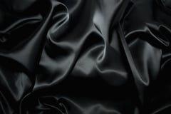 Textura de una seda negra Imágenes de archivo libres de regalías
