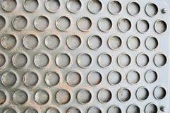 Textura de una superficie industrial fuerte del hierro del hierro con un modelo industrial de círculos Los antecedentes fotos de archivo