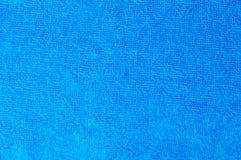 Textura de una toalla azul del algodón como fondo Fotos de archivo libres de regalías