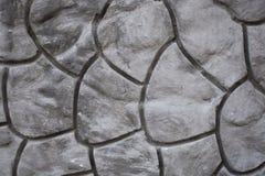 Textura decorativa geométrica del modelo en el muro de cemento del cemento Foto de archivo libre de regalías