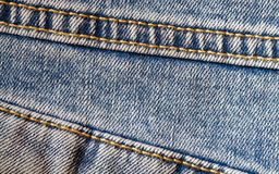 Textura del dril de algodón con una costura Imagen de archivo libre de regalías