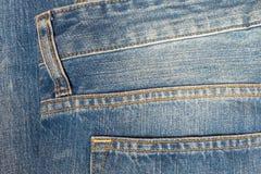 Textura del dril de algodón o parte posterior del pantalón de la mezclilla para el fondo Fotos de archivo