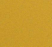 Textura del estuco de la pintura de Digitaces con el fondo del color oro imagen de archivo libre de regalías