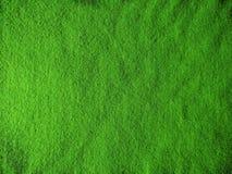 Textura del fieltro homogéneo, fondo verde llano de la tela imagenes de archivo