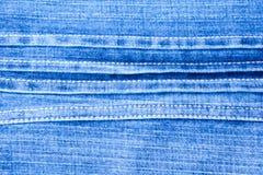 Textura del fondo azul de los vaqueros del dril de algodón Imagen de archivo