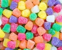 Textura del fondo - cerca para arriba de las pastillas de goma brillantes del caramelo imagenes de archivo
