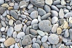 Textura del fondo con las piedras redondas del guijarro Foto de archivo libre de regalías