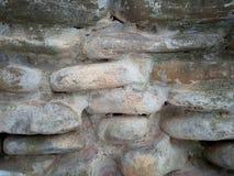Textura del fondo de la pared empedrada que bombea foto de archivo