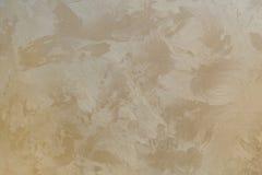 Textura del fondo de las paredes beige del yeso del oro Fotos de archivo