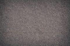 Textura del fondo de un viejo whith lamentable de la pared una capa de la arena Imágenes de archivo libres de regalías