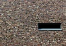 Textura del ladrillo con la ventana Foto de archivo