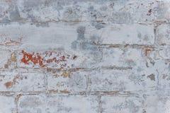 Textura del ladrillo con los rasguños y las grietas Foto de archivo