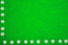 Textura del Libro Verde con los copos de nieve como fondo imagen de archivo libre de regalías