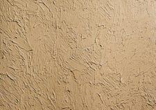 Textura del papel pintado de la arcilla congelada en la pared Ponga en contraste el fondo del claroscuro fotos de archivo