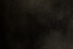 Textura del polvo en el viento sobre fondo negro Foto de archivo libre de regalías